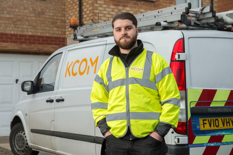 Pro Team engineer standing next to KCOM van