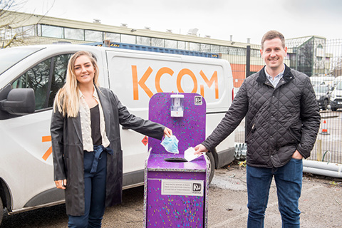 ReWorked's Izzie Glazzard and KCOM's Mark Blenkinsop with the PPE recycling bin