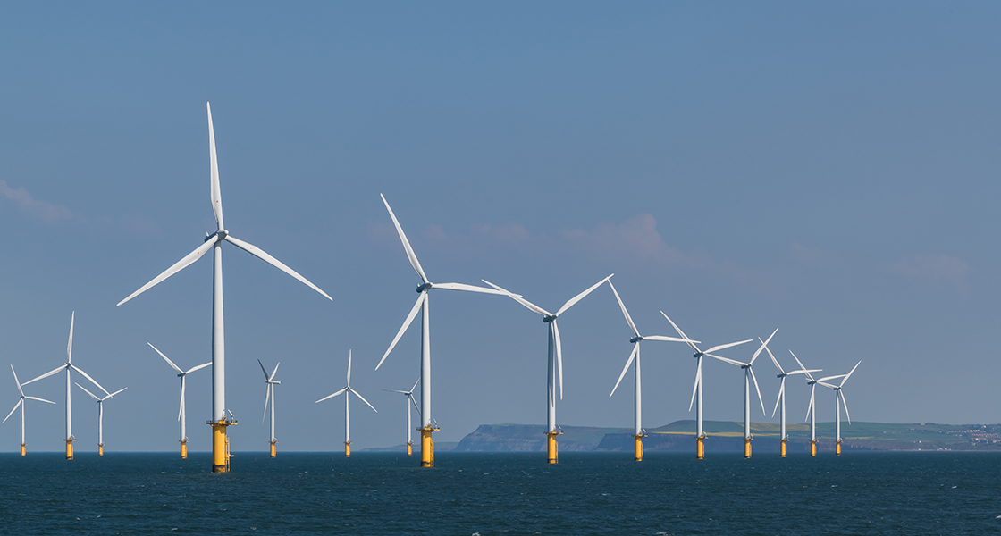 Image shows an wind farm on the ocean