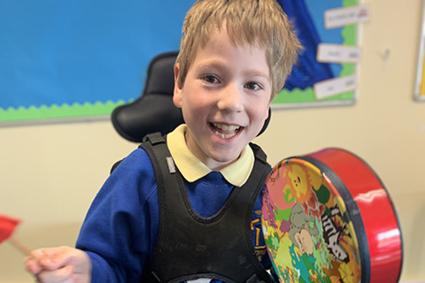 A youngster at Tweendykes School makes music with instruments bought with a KCOM grant